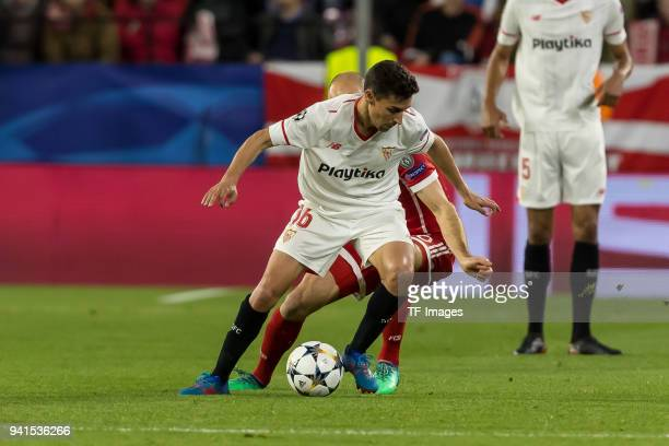 Jesus Navas of Sevilla and Arjen Robben of Bayern Muenchen battle for the ball during the UEFA Champions League QuarterFinal first leg match between...