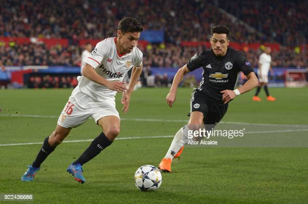 Jesus Navas of Sevilla battles Alexis Sanchez of Manchester United during the UEFA Champions League Round of 16 First Leg match between Sevilla FC...