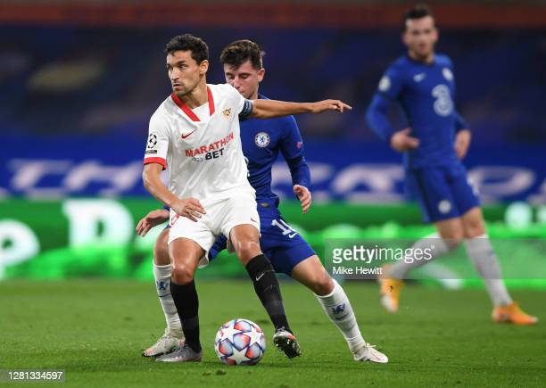 Jesus Navas of Sevilla battles for possession with Mason Mount of Chelsea during the UEFA Champions League Group E stage match between Chelsea FC and...