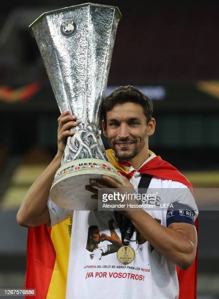 Jesus Navas of Sevilla celebrates with the UEFA Europa League Trophy following his team's victory in the UEFA Europa League Final between Seville and...