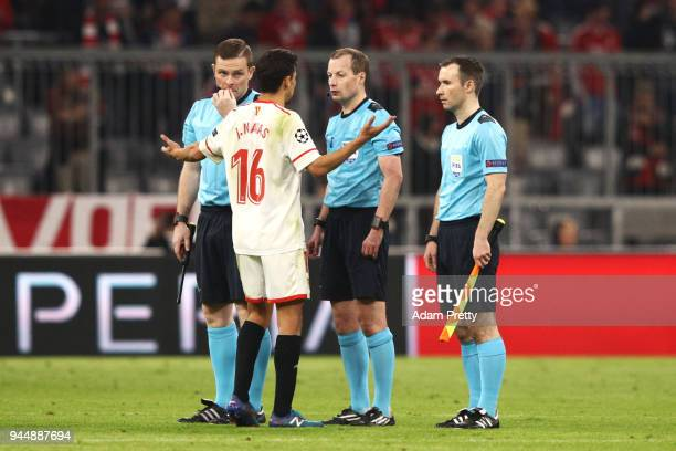 Jesus Navas of Sevilla confronts referee William Collum after the UEFA Champions League Quarter Final Second Leg match between Bayern Muenchen and...