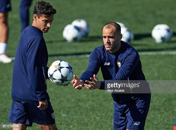 Jesus Navas of Sevilla FC and Sandro Ramirez of Sevilla FC looks on during a Sevilla FC training session prior to their UEFA Champions League match...