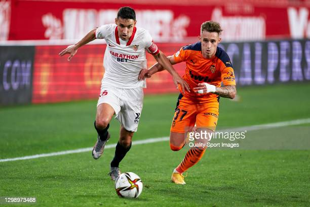 Jesus Navas of Sevilla FC competes for the ball with Alex Blanco of Valencia CF during the Copa Del Rey Match between Sevilla FC and Valencia CF at...