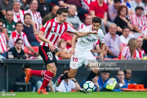 Jesus Navas of Sevilla FC competes for the ball with Inigo Cordoba of Athletic Club during the La Liga match between Athletic Club Bilbao and Sevilla...