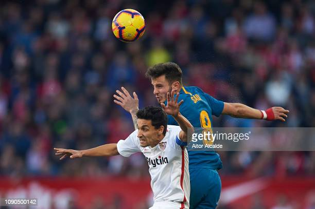 Jesus Navas of Sevilla FC competes for the ball with Saul Niguez of Club Atletico de Madrid during the La Liga match between Sevilla FC and Club...