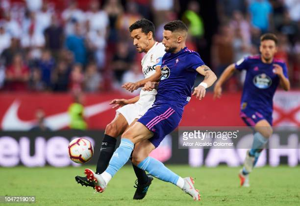 Jesus Navas of Sevilla FC duels for the ball with David Junca of RC Celta de Vigo during the La Liga match between Sevilla FC and RC Celta de Vigo at...