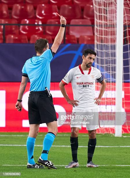 Jesus Navas of Sevilla FC is shown a red card by match referee Felix Brych during the UEFA Champions League Group E stage match between FC Sevilla...