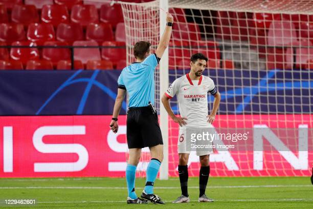 Jesus Navas of Sevilla FC receives a red card from referee Felix Brych during the UEFA Champions League match between Sevilla v Krasnodar at the...