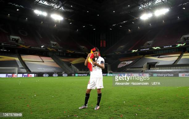 Jesus Navas of Sevilla takes a moment of reflection on the pitch following the UEFA Europa League Final between Seville and FC Internazionale at...