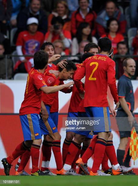 Jesus Navas of Spain celebrates scoring the opening goal with his teammates during the International Friendly match between Spain and South Korea at...