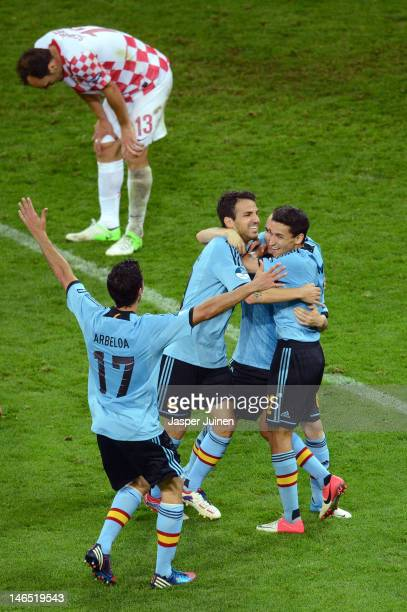 Jesus Navas of Spain celebrates scoring their first goal with team mates during the UEFA EURO 2012 group C match between Croatia and Spain at The...