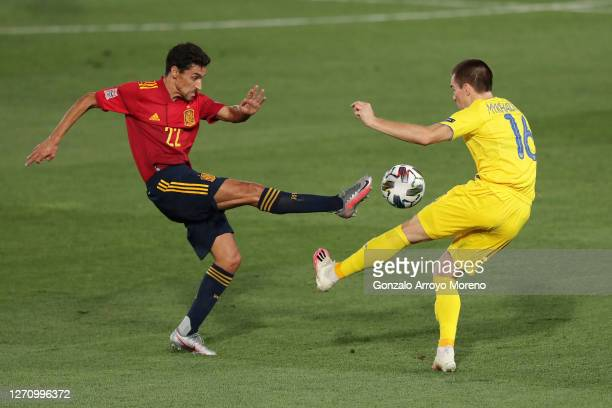 Jesus Navas of Spain competes for the ball with Bogdan Mykhaylichenko of Ukraine during the UEFA Nations League group stage match between Spain and...