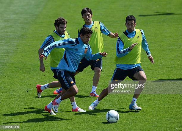 Jesus Navas of Spain duels for the ball with his teammates Juan Mata David Silva and Sergio Busquets during a UEFA EURO 2012 training session on June...