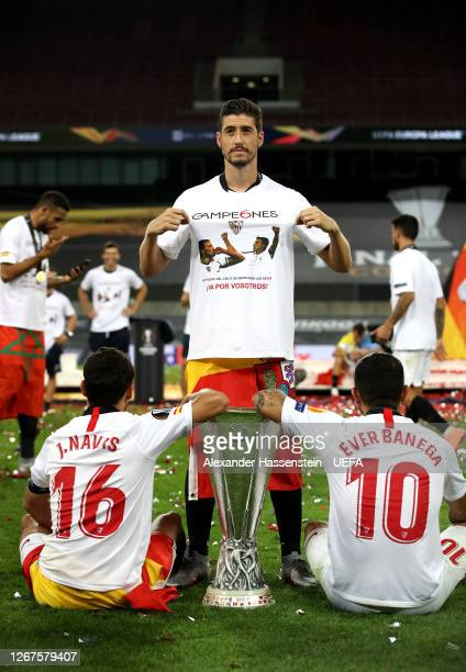 Jesus Navas Sergio Escudero and Ever Banega of Sevilla celebrate with the UEFA Europa League Trophy following their team's victory in during the UEFA...