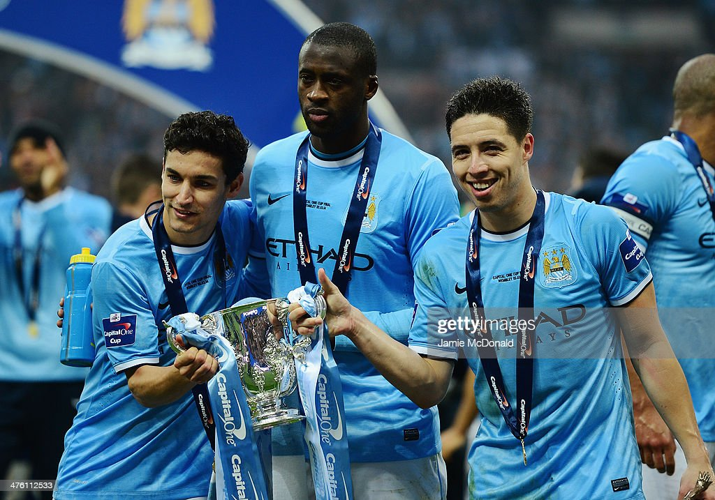 Jesus Navas, Yaya Toure and Samir Nasri of Manchester City pose with the trophy after the Capital One Cup Final between Manchester City and Sunderland at Wembley Stadium on March 2, 2014 in London, England.