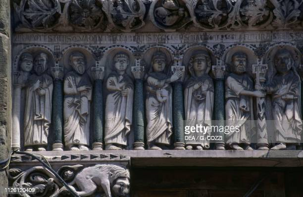 Jesus offering the keys to Saint Peter surrounded by the Virgin and the Apostles relief from the workshop of Guido da Como architrave of the central...
