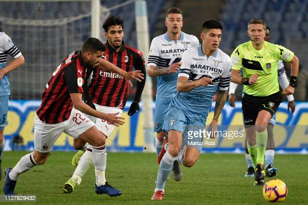 Jesus Pablo Musacchio of AC Milan competes for the ball with Joaquin Correa of SS Lazio during the Coppa Italia semifinal first leg between SS Lazio...
