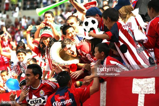 Jesus Padilla of Chivas USA returns to the field after celebrating his second goal of the match with the fans in in the second half of their MLS...