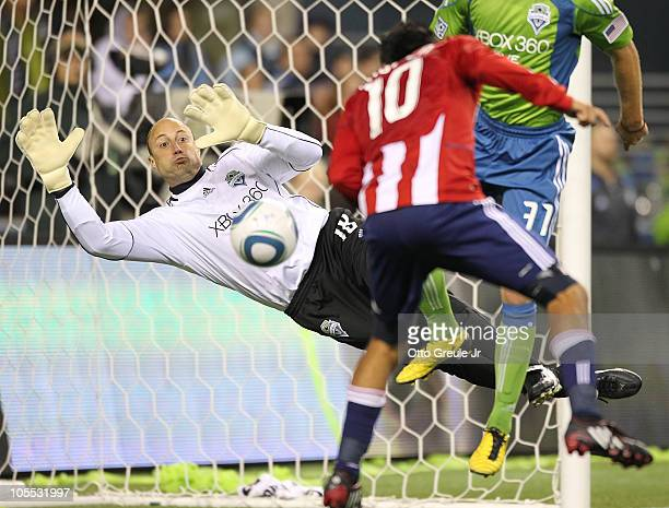 Jesus Padilla of Chivas USA scores a goal against goalkeeper Kasey Keller of the Seattle Sounders FC on October 15 2010 at Qwest Field in Seattle...