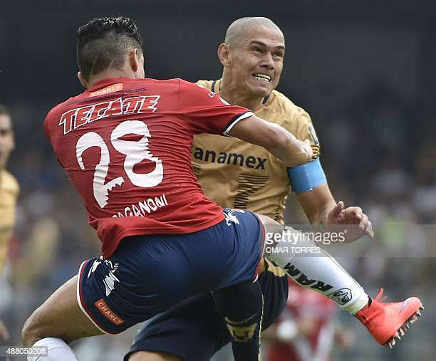 Jesus Paganoni of Veracruz jumps for the ball with Dario Veron of Pumas during their Mexican Apertura tournament football match on September 13 2015...