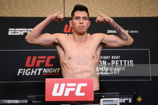 Jesus Pinedo poses on the scale during the UFC Fight Night weighin at Hilton Franklin Cool Springs on March 22 2019 in Franklin Tennessee