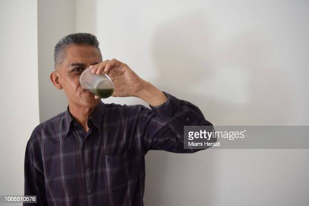 Jesus Rodriguez in Caracas Venezuela has been drinking a homemade concoction made out of guasimo or bay cedar for the last month in hopes of fighting...