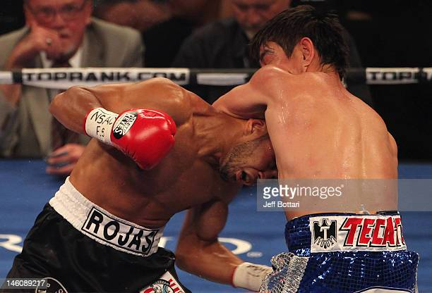 Jesus Rojas lands a low blow against Jorge Arce during their featherweight fight at MGM Grand Garden Arena on June 9 2012 in Las Vegas Nevada