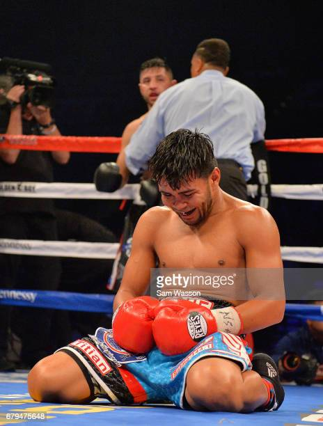 Jesus Rojas reacts after referee Tony Weeks stopped his featherweight fight against Abraham Lopez at MGM Grand Garden Arena on May 5 2017 in Las...