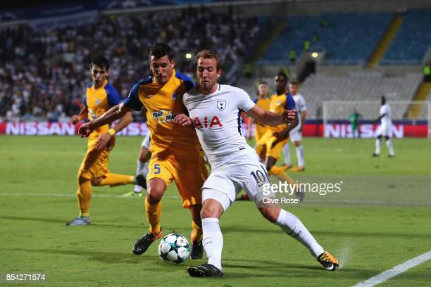 Jesus Rueda of Apoel FC and Harry Kane of Tottenham Hotspur battle for possession during the UEFA Champions League Group H match between Apoel...