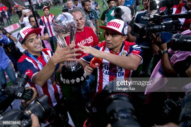 Jesus Sanchez and Edwin Hernandez of Chivas celebrate with the champions trophy after winnig the Final second leg match between Chivas and Tigres...