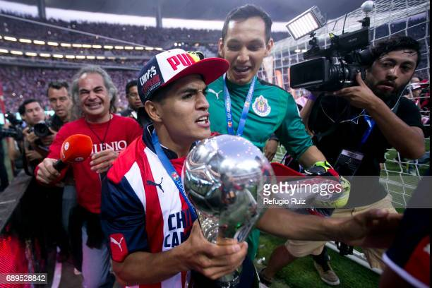 Jesus Sanchez and Rodolfo Cota goalkeeper of Chivas celebrate with the champions trophy after winnig the Final second leg match between Chivas and...
