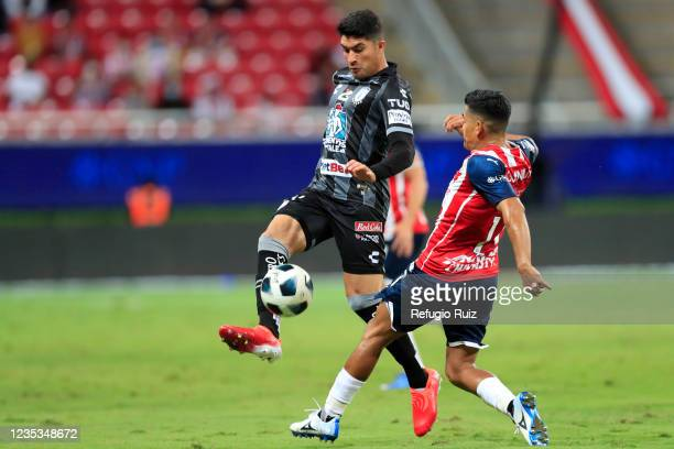 Jesus Sanchez of Chivas fights for the ball with Harold Mosquera of Pachuca during the 9th round match between Chivas and Pachuca as part of the...