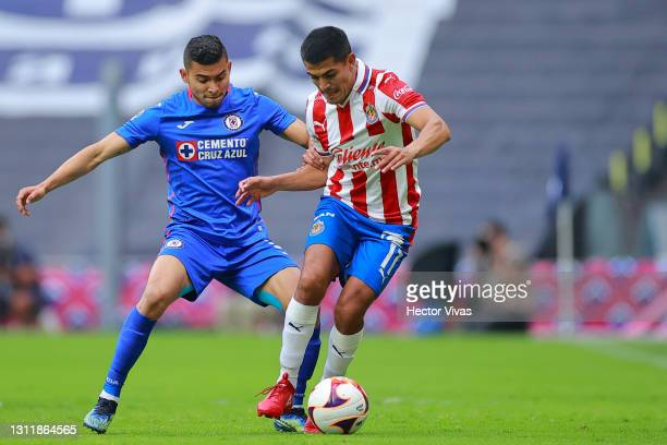 Jesus Sanchez of Chivas struggles for the ball against Orbelin Pineda of Cruz Azul during the 14th round match between Cruz Azul and Chivas as part...