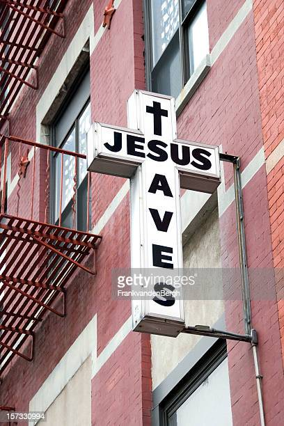 jesus saves on church ceoss sign in harlem - gospel stock photos and pictures