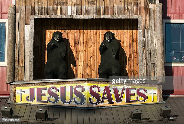 """Jesus Saves"""" sign featuring two black bears is viewed along The Parkway on October 18, 2016 in Pigeon Forge, Tennessee. Located near the entrance to..."""