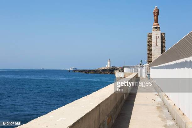 Jesus sculpture and lighthouse at the port exit of Tarifa - Punta de Tarifa: Only 14 Km to Morocco/ Afrika (Cadiz Province/ Andalusia/ Spain)