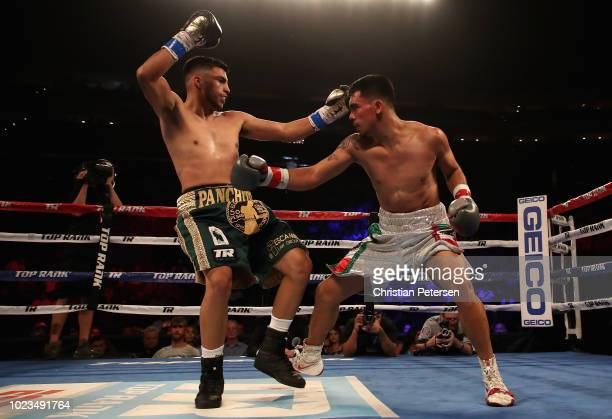 Jesus Serrano of Mexico fights Francisco De Vaca during the featherweight bout at Gila River Arena on August 25 2018 in Glendale Arizona