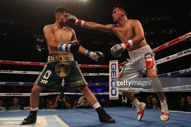 Jesus Serrano of Mexico throws a right on Francisco De Vaca during the featherweight bout at Gila River Arena on August 25 2018 in Glendale Arizona