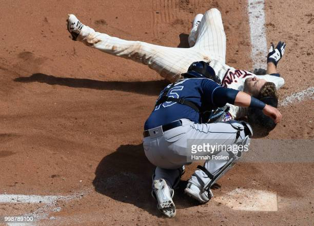 Jesus Sucre of the Tampa Bay Rays defends home plate as he tags out Brian Dozier of the Minnesota Twins during the sixth inning of the game on July...
