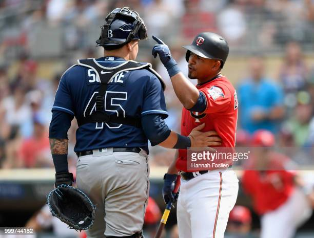 Jesus Sucre of the Tampa Bay Rays gets between Eduardo Escobar of the Minnesota Twins and Diego Castillo of the Tampa Bay Rays as the benches cleared...