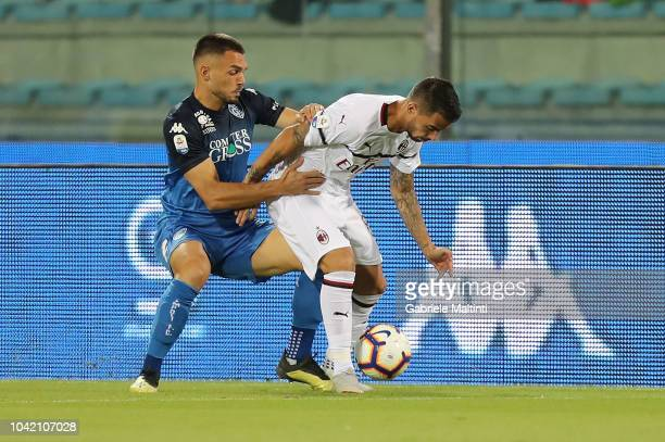 Jesus Suso of AC Milan in action againt Frederic Veseli of Empoli FC during the serie A match between Empoli and AC Milan at Stadio Carlo Castellani...