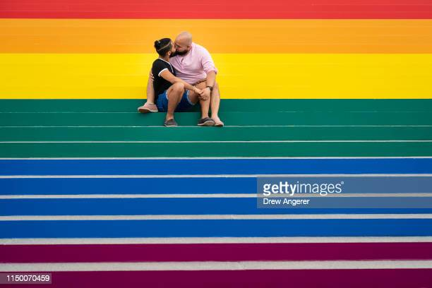 Jesus Tavarez and Juan De La O both from The Bronx New York kiss on the steps that are covered in rainbow colors for Pride Month at Franklin D...