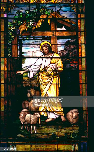 jesus the good shepherd depicted on stained glass - jesus the good shepherd stock pictures, royalty-free photos & images