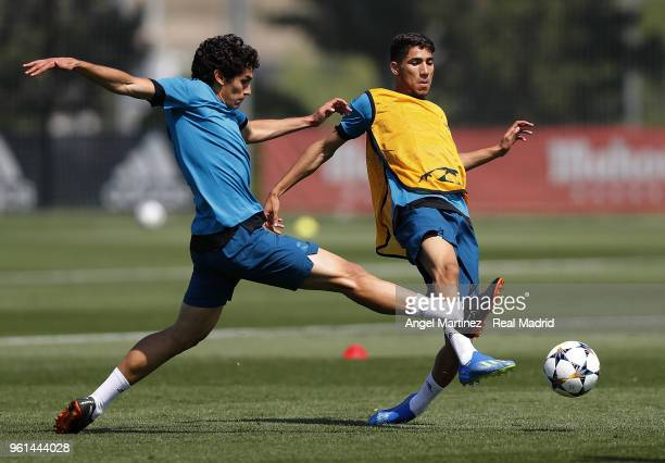 Jesus Vallejo and Achraf Hakimi of Real Madrid in action during a training session at Valdebebas training ground on May 22 2018 in Madrid Spain