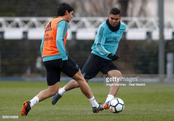 Jesus Vallejo and Casemiro of Real Madrid in action during a training session at Valdebebas training ground on March 2 2018 in Madrid Spain