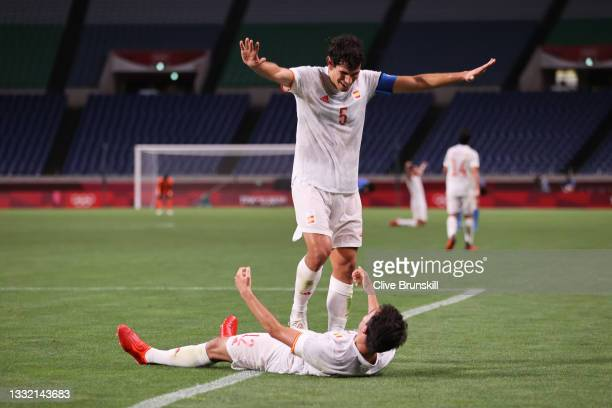 Jesus Vallejo and Eric Garcia of Team Spain celebrate after victory in the Men's Football Semi-final match between Japan and Spain on day eleven of...