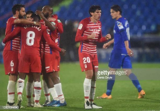 Jesus Vallejo of Granada CF celebrates victory with teammates at full time following the La Liga Santander match between Getafe CF and Granada CF at...