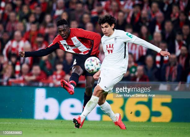 Jesus Vallejo of Granada CF duels for the ball with Inaki Williams of Athletic Club during the Copa del Rey SemiFinal 1st Leg match between Athletic...