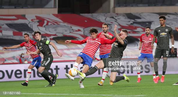 Jesus Vallejo of Granada CF is challenged by Scott McTominay of Manchester United during the UEFA Europa League Quarter Final First Leg match between...
