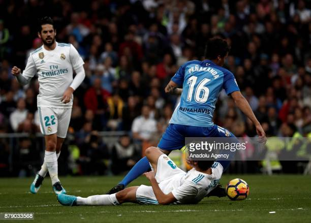 Jesus Vallejo of Real Madrid and Adalberto Penaranda of Malaga vie for the ball during the La Liga match between Real Madrid and Malaga at Santiago...